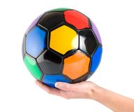 Soccer ball in hand Stock Photography