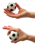 Soccer ball in hand Stock Image