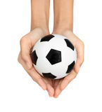 Soccer ball in hand Stock Images