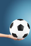 Soccer ball in hand Royalty Free Stock Image