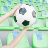 Soccer ball on hand Royalty Free Stock Photos