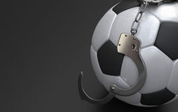 Soccer ball with handcuffs Royalty Free Stock Images