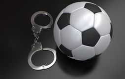 Soccer ball with handcuffs Stock Images