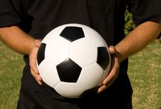 Soccer ball and hands Stock Photo