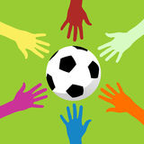 Soccer ball and hands around royalty free stock image