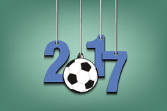 Soccer ball  and 2017 hanging on strings. New Year numbers 2017 and soccer ball as a Christmas decorations hanging on strings. Vector illustration Royalty Free Stock Images