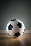 Soccer ball on hardwood floor Stock Image