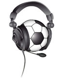 Soccer ball in the headphones. With a microphone on a white background Royalty Free Stock Images
