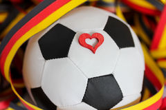 A soccer ball, a heart and streamers Stock Image