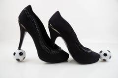 Soccer ball and high heels Stock Photos