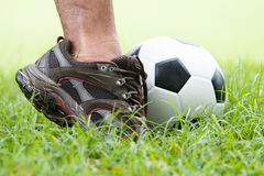 Soccer ball with his feet Royalty Free Stock Image