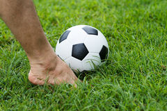 Soccer ball with his feet Royalty Free Stock Photo