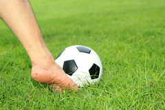 Soccer ball with his feet Stock Photography