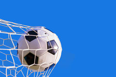 Soccer ball hit the net Stock Photos
