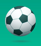 Soccer Ball Hovering in front of Green Background Stock Photo