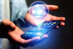 Soccer ball icon over device - Sport and technology concept. View of a Soccer ball icon over device - Sport and technology concept royalty free stock images