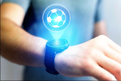 Soccer ball icon over device - Sport and technology concept. View of a Soccer ball icon over device - Sport and technology concept royalty free stock photo