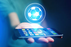 Soccer ball icon over device - Sport and technology concept. View of a Soccer ball icon over device - Sport and technology concept stock images