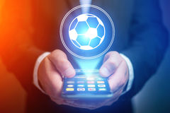 Soccer ball icon over device - Sport and technology concept. View of a Soccer ball icon over device - Sport and technology concept royalty free stock photography