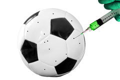 Soccer ball injection. Soccer ball with hand and syringe royalty free stock image