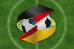 Soccer ball inside exchange symbol with German flag. Stock Images