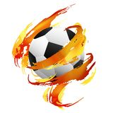 Soccer ball inside orange, red and yellow paint smears. Soccer ball ine orange, red and yellow paint smears on the white background Stock Photo