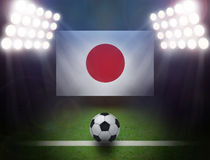 Soccer Ball with Japan Flag in stadium. Stock Image