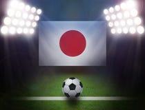 Soccer Ball with Japan Flag in stadium. Soccer Ball with Japan Flag,bright spotlights Stock Image