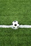 Soccer ball on kick point Stock Images