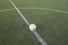 Soccer ball at kickoff on fake soccer field. Soccer ball at kickoff spot on fake soccer field Royalty Free Stock Photography