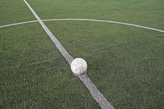Soccer ball at kickoff on fake soccer field Royalty Free Stock Photography