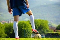 Soccer ball at the kickoff of a game Royalty Free Stock Photo