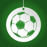 Soccer ball label on green background Royalty Free Stock Photo