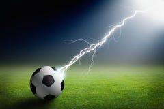 Soccer ball, lightning, spotlight Royalty Free Stock Image