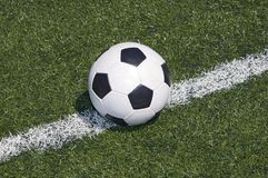 Soccer ball on the line royalty free stock photos