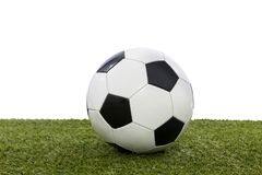 Soccer ball. Located on the grass of the court Royalty Free Stock Image