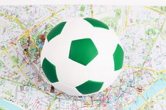 Soccer ball is located on a map Royalty Free Stock Photos
