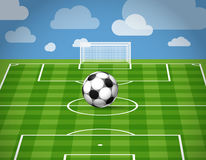Soccer ball lying on the grass Stock Image