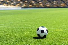 Soccer ball lying on green grass. Of stadium Royalty Free Stock Photos