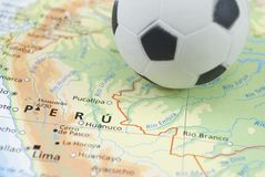 Soccer ball on map Royalty Free Stock Photos