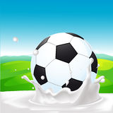 Soccer ball in milk splash on natural background - vector Royalty Free Stock Photo