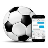 Soccer ball and mobile phone with sms chat screen Royalty Free Stock Photos