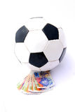 Soccer ball with money Royalty Free Stock Photo