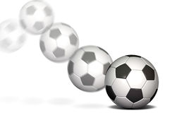 Soccer ball in motion. Soccer ball on a white background with a motion blur Stock Image