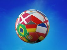 Soccer ball with national team flags. 3D rendering of soccer ball with superimposed national flags representing major national soccer teams shot against blue sky Royalty Free Stock Photo