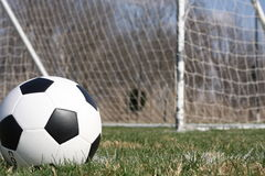Soccer ball near the goal. Checkered Soccer ball near the goal Royalty Free Stock Images