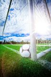 Soccer ball near a goal post. In football stadium Royalty Free Stock Photos