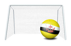 A soccer ball near the net with the Brunei flag Stock Photos