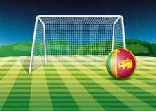 A soccer ball near net with the flag of Sri Lanka Royalty Free Stock Photo