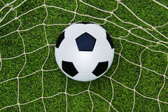 The soccer ball on the net Stock Photography